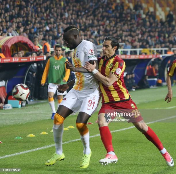 Mbaye Diagne of Galatasaray and Murat Akca of Evkur Yeni Malatyaspor vie for the ball during Ziraat Turkish Cup semi final second leg match between...