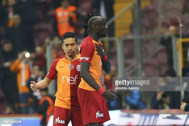 Mbaye Diagne of Galatasaray celebrates with his teammate Yuto Nagatomo after scoring a goal during Turkish Super Lig soccer match between Galatasaray...