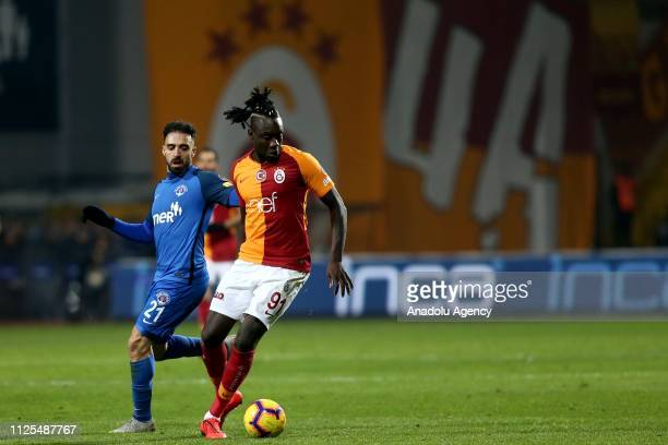 Mbaye Diagne of Galatasaray competes with Abdul Rahman Khalili of Kasimpasa during the Turkish Super Lig soccer match between Kasimpasa and...