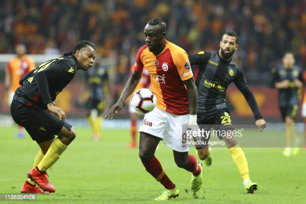 Mbaye Diagne of Galatasaray in action against Arturo Mina of Evkur Yeni Malatyaspor during the Turkish Super Lig soccer match between Galatasaray and...