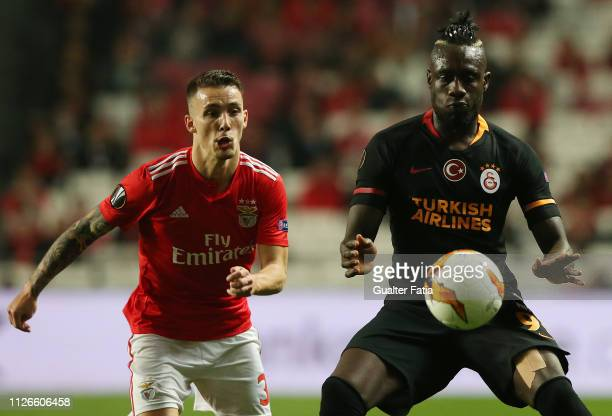 Mbaye Diagne of Galatasaray with Alex Grimaldo of SL Benfica in action during the UEFA Europa League Round of 32 Second Leg match between SL Benfica...