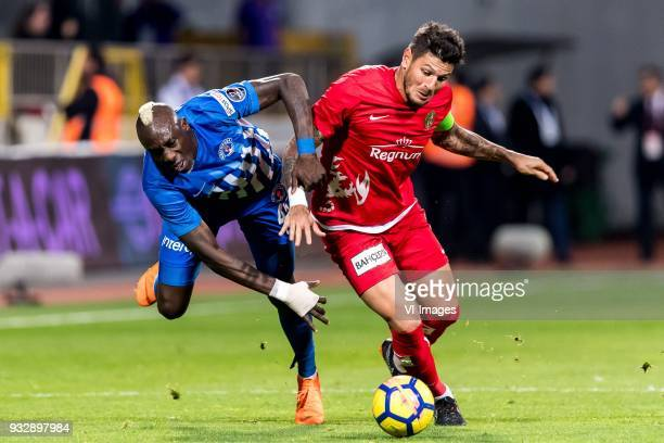Mbaye Diagne of Kasimpasa AS Diego Ângelo de Oliveira of Antalyaspor AS during the Turkish Spor Toto Super Lig match between Kasimpasa AS and...