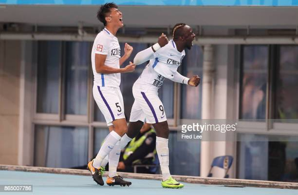Mbaye Diagne of Tianjin Elion FC celebrates during the Chinese Super League match between Tianjin Elion FC and Beijing Guoan FC at Tianjin Olympic...