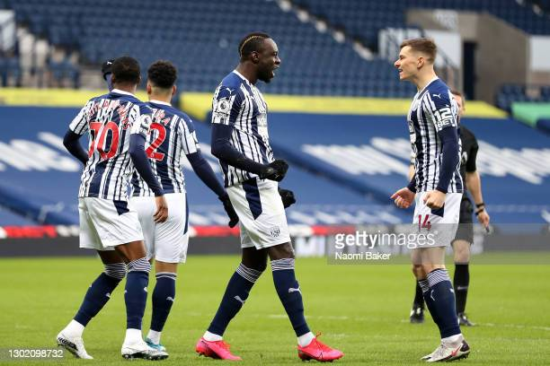 Mbaye Diagne of West Bromwich Albion celebrates with team mate Conor Townsend after scoring their side's first goal during the Premier League match...