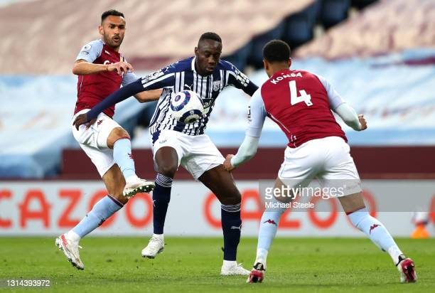 Mbaye Diagne of West Bromwich Albion is put under pressure by Ahmed Elmohamady of Aston Villa and Ezri Konsa of Aston Villa during the Premier League...