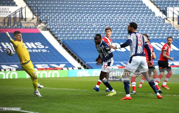 Mbaye Diagne of West Bromwich Albion scores their sides first goal past Fraser Forster of Southampton which is later disallowed by VAR during the...