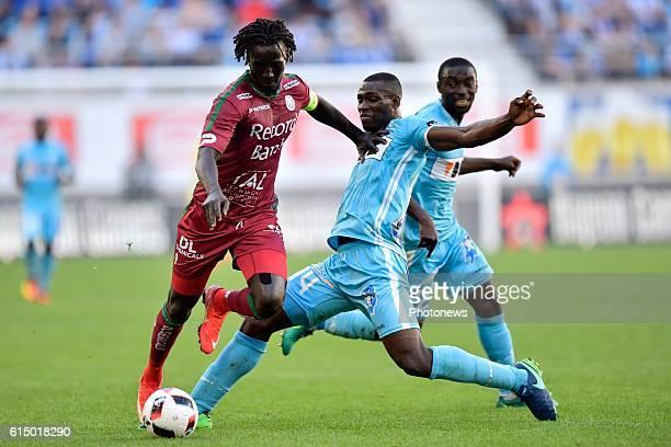 Mbaye Leye forward of SV Zulte Waregem is challenged by Anderson Esiti midfielder of KAA Gent during the Jupiler Pro League match between KAA Gent...