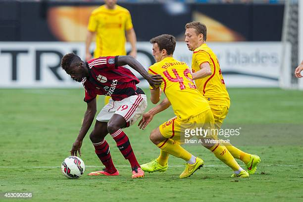 Mbaye Niang of AC Milan battles for the ball with Jack Robinson and Lucas Leiva of Liverpool during first half action in the Guinness International...