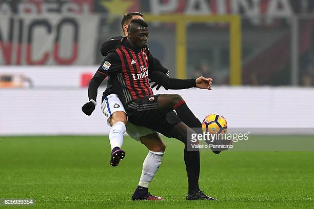 Mbaye Niang of AC Milan competes with Danilo D Ambrosio of FC Internazionale during the Serie A match between AC Milan and FC Internazionale at...