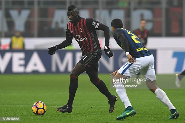 Mbaye Niang of AC Milan in action against Jeison Murillo of FC Internazionale during the Serie A match between AC Milan and FC Internazionale at...
