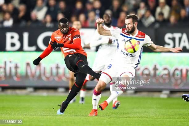 Mbaye Niang of Rennes and Lucas Tousart of Lyon during the Ligue 1 match between Rennes and Lyon at Roazhon Park on March 29 2019 in Rennes France