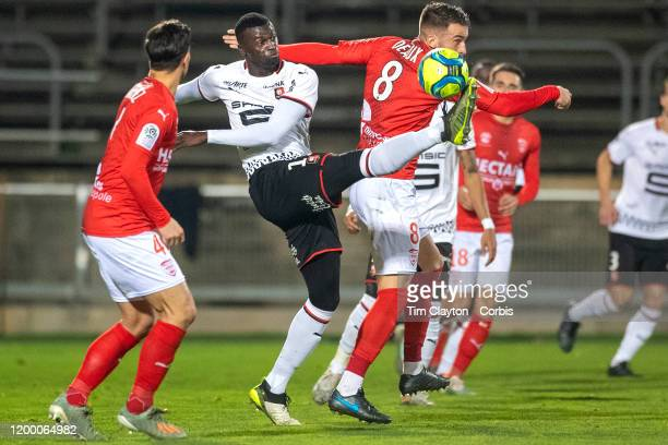 Mbaye Niang of Rennes challenged by Lucas Deaux of Nimes during the Nimes Olympique V Stade Rennes French Ligue 1 regular season match at Stade des...
