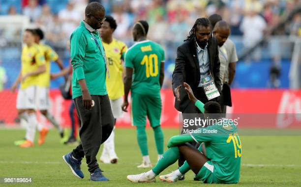 Mbaye Niang of Senegal and Aliou Cisse Head coach of Senegal shakes hands after the 2018 FIFA World Cup Russia group H match between Senegal and...