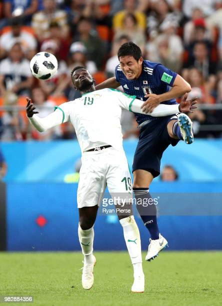 Mbaye Niang of Senegal and Gen Shoji of Japan compete in the air for the ball during the 2018 FIFA World Cup Russia group H match between Japan and...