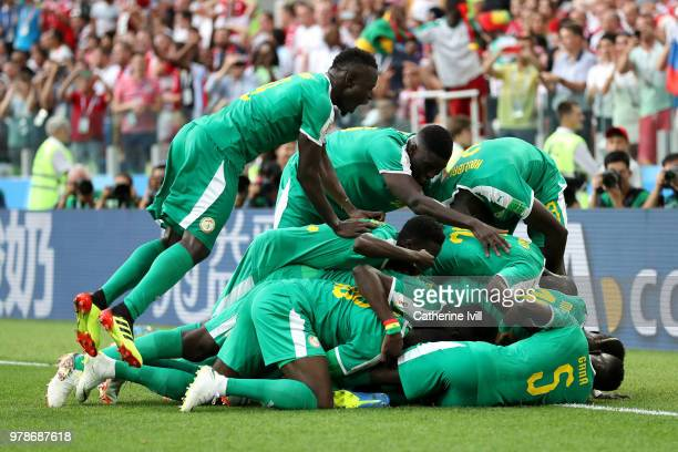 Mbaye Niang of Senegal celebrates after scoring his team's second goal with teammates during the 2018 FIFA World Cup Russia group H match between...