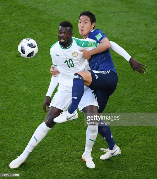 Mbaye Niang of Senegal is challenged by Gen Shoji of Japan during the 2018 FIFA World Cup Russia group H match between Japan and Senegal at...