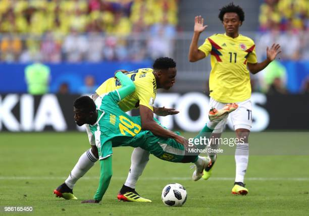Mbaye Niang of Senegal is challenged by Yerry Mina of Colombia during the 2018 FIFA World Cup Russia group H match between Senegal and Colombia at...