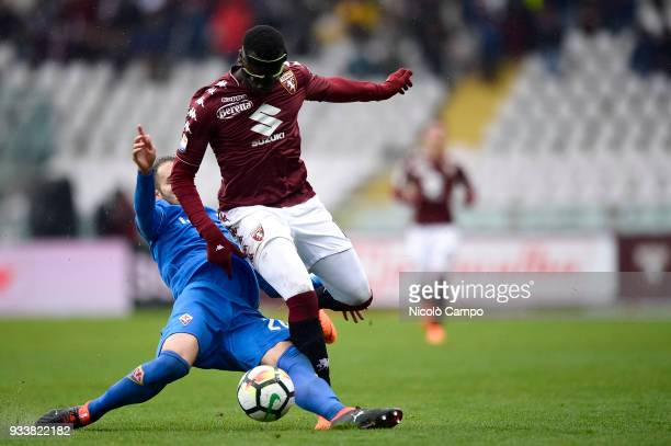 MBaye Niang of Torino FC is tackled by German Pezzella of ACF Fiorentina during the Serie A football match between Torino FC and ACF Fiorentina ACF...