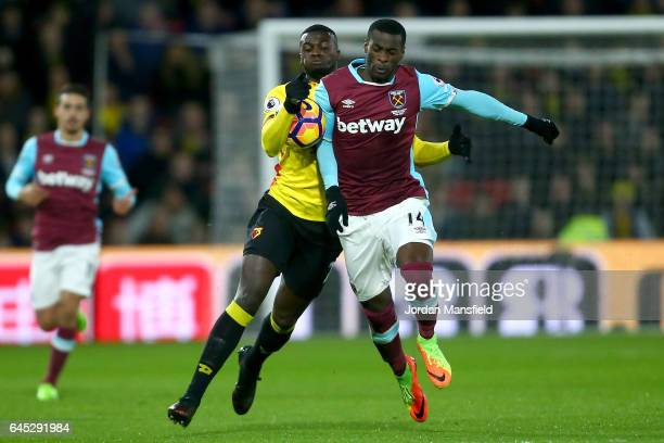 Mbaye Niang of Watford and Pedro Obiang of West Ham United battle for the ball during the Premier League match between Watford and West Ham United at...