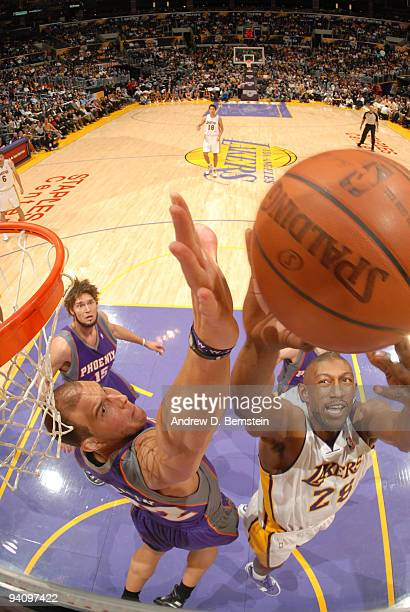 6348ebf10db Mbenga of the Los Angeles Lakers goes up for a shot against Taylor Griffin  of the