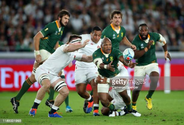 Mbongeni Mbonambi of South Africa offloads the ball during the Rugby World Cup 2019 Final between England and South Africa at International Stadium...