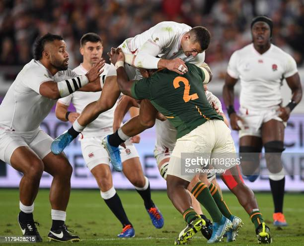 Mbongeni Mbonambi of South Africa tackles Jonny May of England during the Rugby World Cup 2019 Final between England and South Africa at...