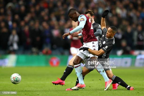 Mbwana Samatta of Aston Villa and Youri Tielemans of Leicester City in action during the Carabao Cup Semi Final match between Aston Villa and...
