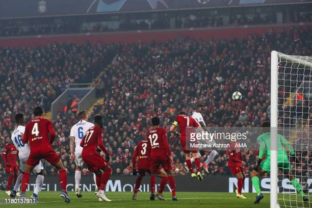 Mbwana Samatta of KRC Genk scores a goal to make it 11 during the UEFA Champions League group E match between Liverpool FC and KRC Genk at Anfield on...