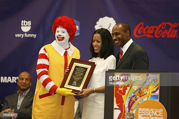 Mc Donald's Ronald McDonald and Kevin Newell US Vice President and General Manager for McDonald's Great Southern Region presents a plaque to Michelle...
