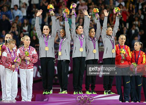 Mc Kayla Maroney Jordyn Wieber Gabrielle Douglas Alexandra Raisman and Kyla Ross of the United States celebrate on the podium after winning the gold...