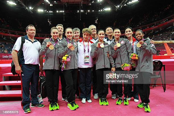 Mc Kayla Maroney Jordyn Wieber Gabrielle Douglas Alexandra Raisman and Kyla Ross and the coaching staff of the United States celebrate after winning...