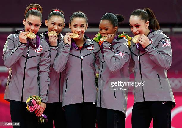 Mc Kayla Maroney Kyla Ross Alexandra Raisman Gabrielle Douglas and Jordyn Wieber of the United States celebrate after winning the gold medal in the...