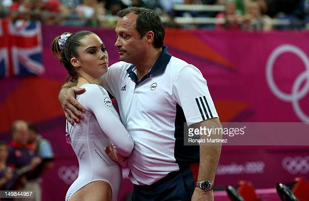 Mc Kayla Maroney of the United States looks on as she is consoled by coach Yin Alvarez after she fell on a dismount while competing in the Artistic...