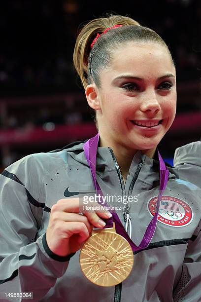 Mc Kayla Maroney of the United States poses with the gold medal after helping the United States win the Artistic Gymnastics Women's Team final on Day...