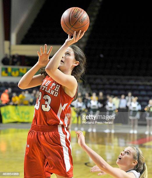 McAuley Madeline Hasson takes a shot after knocking McAuley Ayla Tartre down as McAuley plays South Portland in Class A West Semifinals in the Maine...