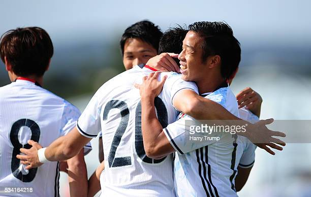 MCayman Togashi of Japan celebrates after scoring his sides first goal during the Toulon Tournament match between Guinea and Japan at Stade Antoinr...