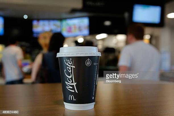 A McCafe hot beverage cup sits on a table inside a McDonald's Corp restaurant in Manchester UK on Monday Aug 10 2015 McDonald's Chief Executive...