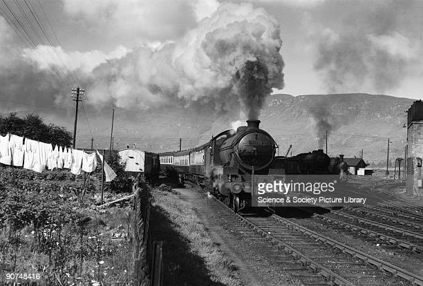 McCailin Mor K1 Class steam locomotive leaving Fort William dirtying laundry as it passes Photograph by Bishop Eric Treacy Treacy was often allowed...