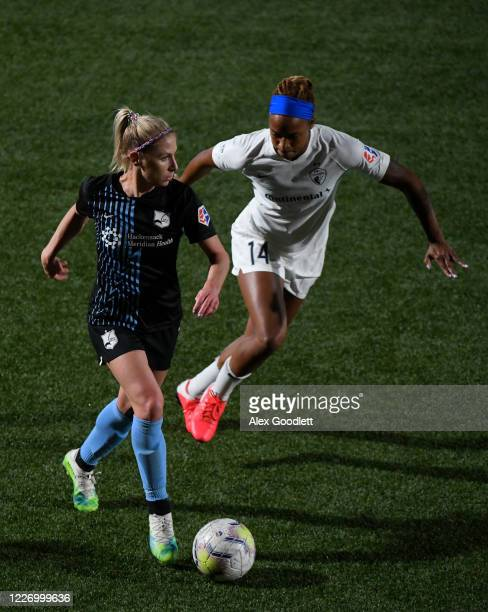 McCall Zerboni of Sky Blue FC drives against Jessica McDonald of North Carolina Courage during a game on day 8 of the NWSL Challenge Cup at Zions...