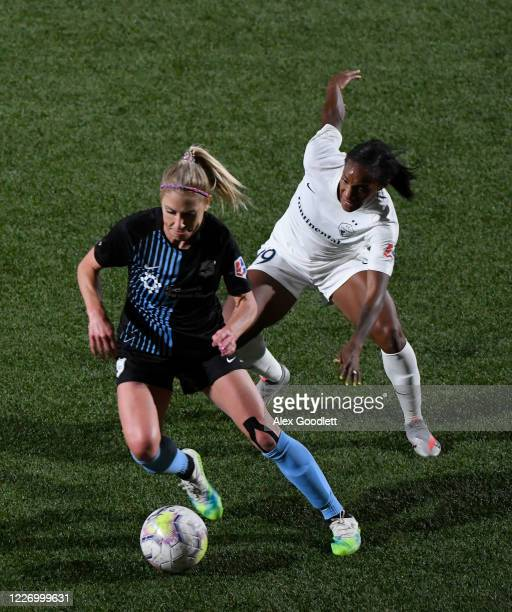 McCall Zerboni of Sky Blue FC drives around Crystal Dunn of North Carolina Courage during a game on day 8 of the NWSL Challenge Cup at Zions Bank...