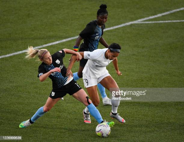 McCall Zerboni of Sky Blue FC fights for the ball against Lynn Williams of North Carolina Courage during a game on day 8 of the NWSL Challenge Cup at...