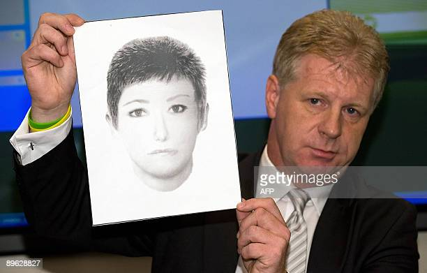 McCann family spokesman Clarence Mitchell holds up a photofit at a press conference in central London on August 6 2009 of a woman that they wish to...