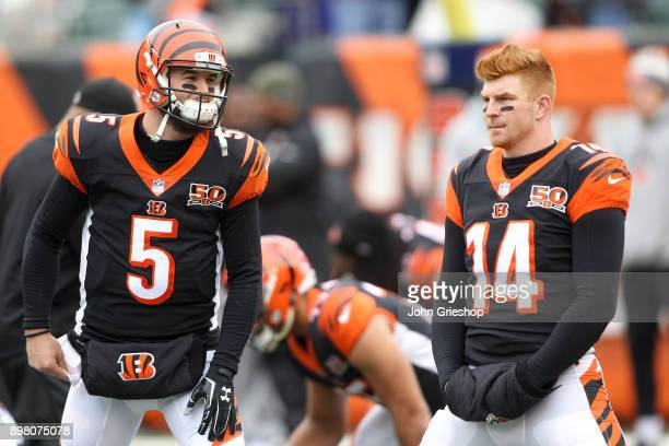 McCarron and Andy Dalton of the Cincinnati Bengals stretch prior to the game against the Detroit Lions at Paul Brown Stadium on December 24 2017 in...