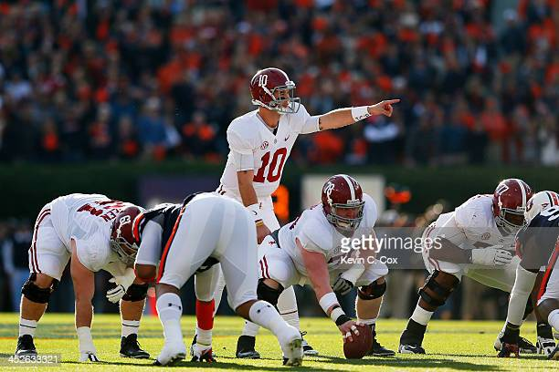 McCarron and Chad Lindsay of the Alabama Crimson Tide prepare for a play in the first quarter against the Auburn Tigers at JordanHare Stadium on...