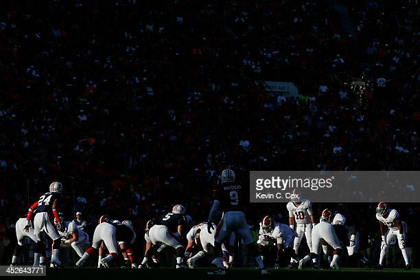 McCarron of the Alabama Crimson Tide calls a play in the second quarter against the Auburn Tigers at JordanHare Stadium on November 30 2013 in Auburn...