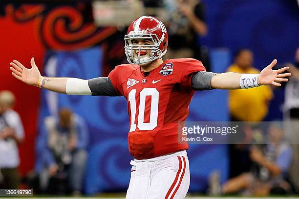 McCarron of the Alabama Crimson Tide celebrates after a touchdown late in the fourth quarter against the Louisiana State University Tigers during the...