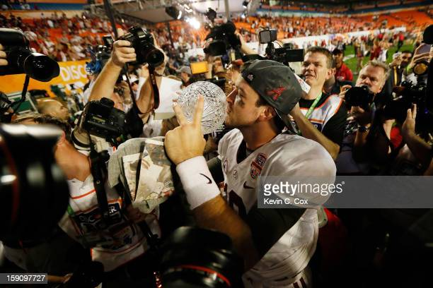 McCarron of the Alabama Crimson Tide celebrates with the Coach's Trophy after defeating the Notre Dame Fighting Irish by a score of 4214 to win the...