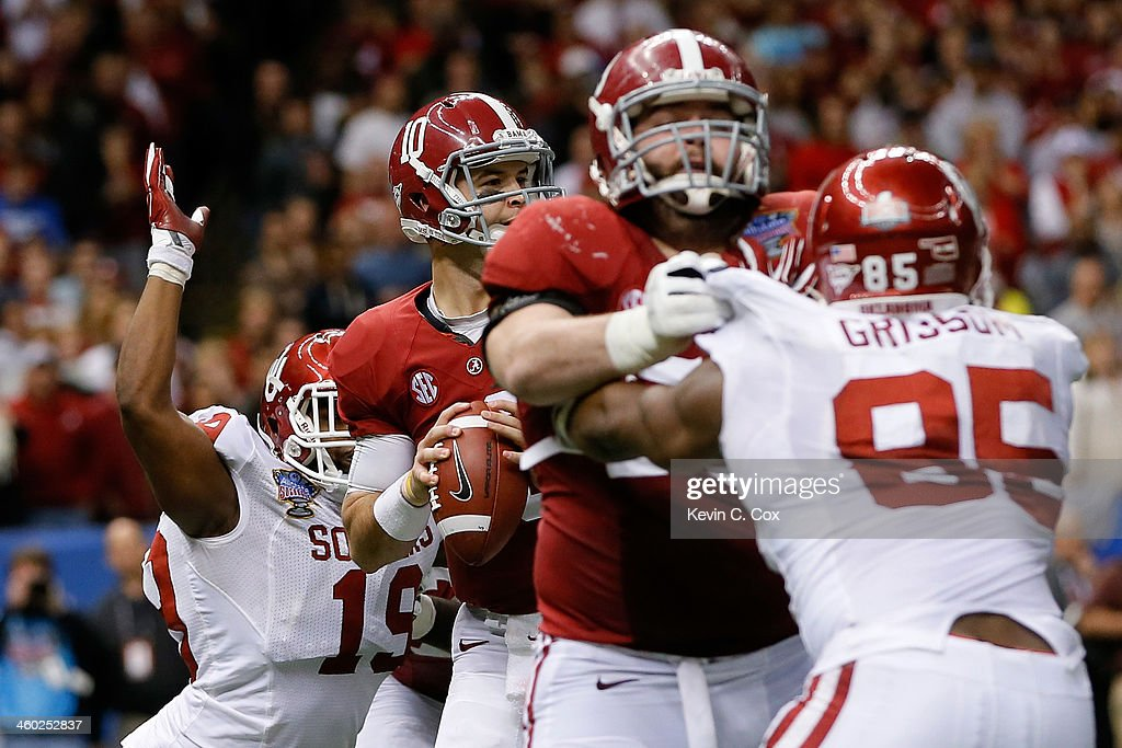 AJ McCarron #10 of the Alabama Crimson Tide has the ball stripped from him by Eric Striker #19 of the Oklahoma Sooners during the Allstate Sugar Bowl at the Mercedes-Benz Superdome on January 2, 2014 in New Orleans, Louisiana. The Sooners defeated the Crimson Tide 45-31.