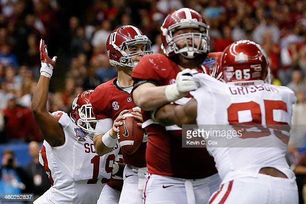McCarron of the Alabama Crimson Tide has the ball stripped from him by Eric Striker of the Oklahoma Sooners during the Allstate Sugar Bowl at the...