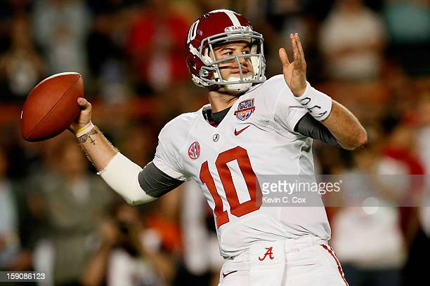 McCarron of the Alabama Crimson Tide passes against the Notre Dame Fighting Irish during the 2013 Discover BCS National Championship game at Sun Life...
